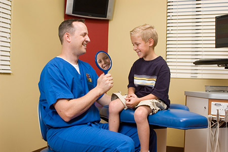 Boy Smiling with Dr. Johnson at the Pediatric Dentist Office in Casa Grande, Mesa and Chandler, AZ