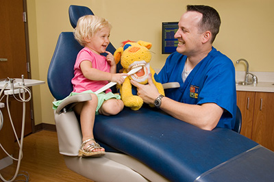 Doctor with child at the Pediatric Dentist Office in Casa Grande, Mesa and Chandler, AZ
