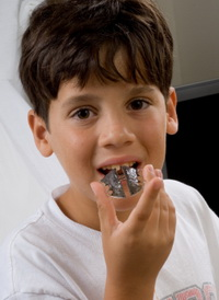 Boy with Retainer at the Pediatric Dentist Office in Casa Grande, Mesa and Chandler, AZ