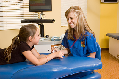 Hygienist with Child at the Pediatric Dentist Office in Casa Grande, Mesa and Chandler, AZ