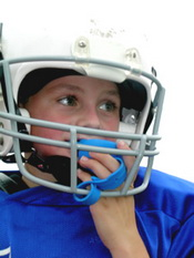 Child in Football Helmet with Mouth Guard at the Pediatric Dentist Office in Casa Grande, Mesa and Chandler, AZ